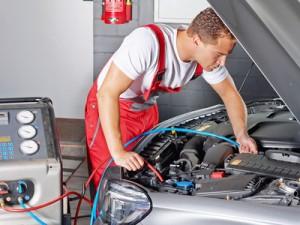 Car mechanics checks the air handling unit of a car